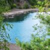 and a lake with clean turquoise water